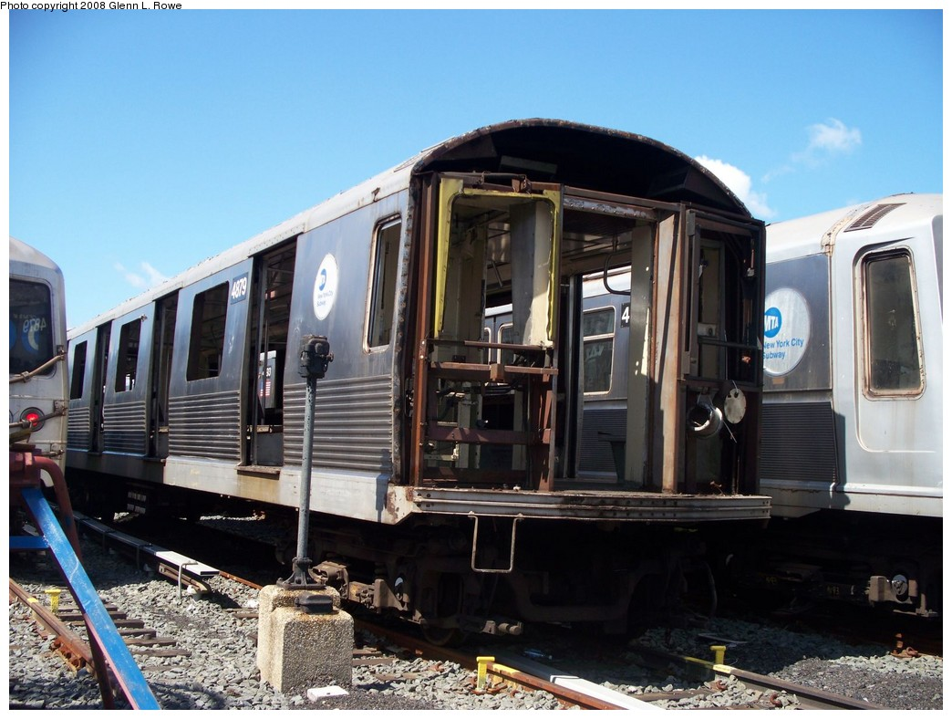 (220k, 1044x788)<br><b>Country:</b> United States<br><b>City:</b> New York<br><b>System:</b> New York City Transit<br><b>Location:</b> 207th Street Yard<br><b>Car:</b> R-42 (St. Louis, 1969-1970)  4879 <br><b>Photo by:</b> Glenn L. Rowe<br><b>Date:</b> 6/19/2008<br><b>Notes:</b> Scrap<br><b>Viewed (this week/total):</b> 3 / 1284