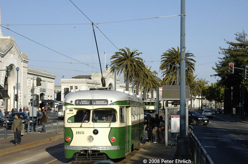 (187k, 864x574)<br><b>Country:</b> United States<br><b>City:</b> San Francisco/Bay Area, CA<br><b>System:</b> SF MUNI<br><b>Location:</b> Embarcadero/Bay <br><b>Route:</b> F-Market<br><b>Car:</b> SF MUNI PCC Torpedo Double-End (St. Louis Car Co., 1948)  1015 <br><b>Photo by:</b> Peter Ehrlich<br><b>Date:</b> 6/2/2008<br><b>Notes:</b> Embarcadero/Bay outbound, trailing view.  With 162 (Muni B-Type) inbound across street.<br><b>Viewed (this week/total):</b> 0 / 569