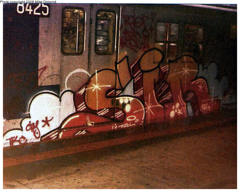 (183k, 820x655)<br><b>Country:</b> United States<br><b>City:</b> New York<br><b>System:</b> New York City Transit<br><b>Line:</b> BMT Canarsie Line<br><b>Location:</b> Rockaway Parkway <br><b>Route:</b> L<br><b>Car:</b> R-30 (St. Louis, 1961) 8425 <br><b>Photo by:</b> Mike Ormond<br><b>Date:</b> 1982<br><b>Viewed (this week/total):</b> 2 / 2651