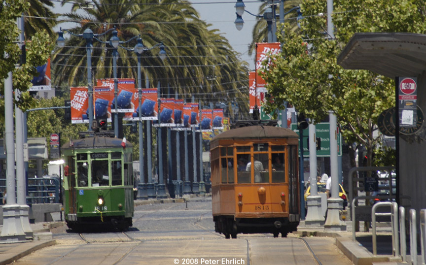(211k, 864x538)<br><b>Country:</b> United States<br><b>City:</b> San Francisco/Bay Area, CA<br><b>System:</b> SF MUNI<br><b>Location:</b> Embarcadero/Ferry Building<br><b>Route:</b> F-Market<br><b>Car:</b> Milan Milano/Peter Witt (1927-1930) 1818 <br><b>Photo by:</b> Peter Ehrlich<br><b>Date:</b> 6/12/2008<br><b>Notes:</b> Outbound and inbound cars meeting at the Ferry Building stop.<br><b>Viewed (this week/total):</b> 1 / 541