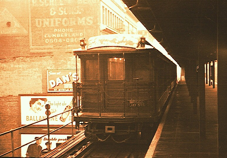 (158k, 772x538)<br><b>Country:</b> United States<br><b>City:</b> New York<br><b>System:</b> New York City Transit<br><b>Line:</b> BMT Myrtle Avenue Line<br><b>Location:</b> Bridge/Jay Street <br><b>Car:</b> BMT Elevated Gate Car  <br><b>Photo by:</b> Brian J. Cudahy<br><b>Date:</b> 1953<br><b>Viewed (this week/total):</b> 8 / 2993
