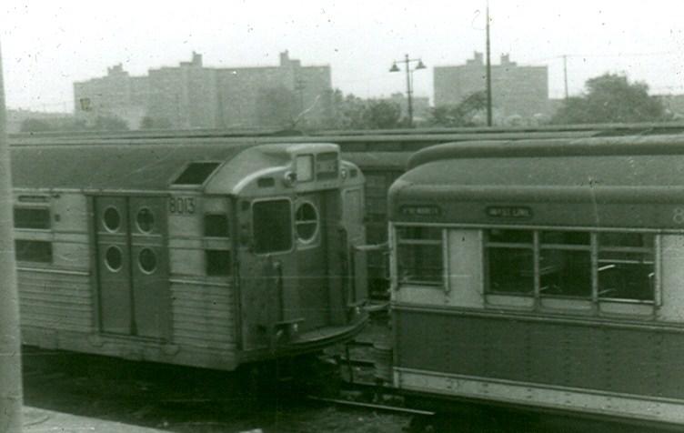 (77k, 752x476)<br><b>Country:</b> United States<br><b>City:</b> New York<br><b>System:</b> New York City Transit<br><b>Location:</b> Rockaway Parkway (Canarsie) Yard<br><b>Car:</b> R-11 (Budd, 1949) 8013 <br><b>Photo by:</b> Brian J. Cudahy<br><b>Date:</b> 1958<br><b>Notes:</b> R-11 and Bluebird at Rockway Parkway.<br><b>Viewed (this week/total):</b> 0 / 2018