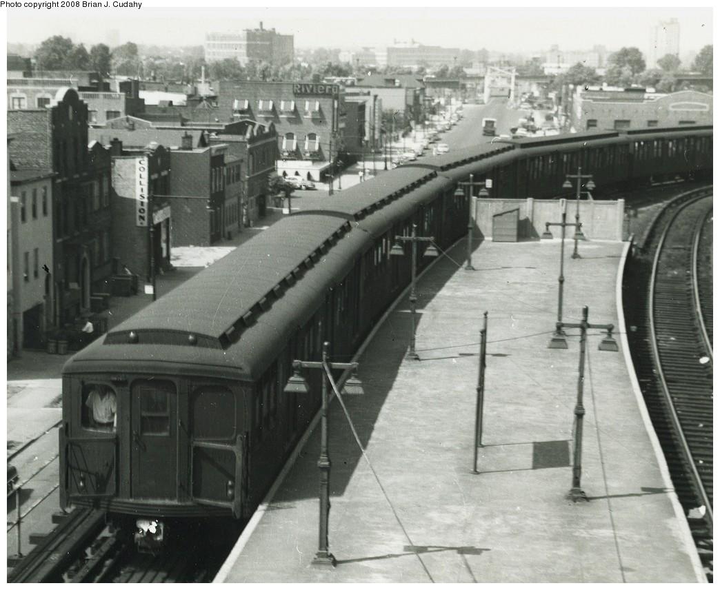 (210k, 1044x856)<br><b>Country:</b> United States<br><b>City:</b> New York<br><b>System:</b> New York City Transit<br><b>Location:</b> Coney Island/Stillwell Avenue<br><b>Car:</b> BMT A/B-Type Standard  <br><b>Photo by:</b> Brian J. Cudahy<br><b>Date:</b> 1954<br><b>Notes:</b> West End Express arrives on Stillwell Track H.<br><b>Viewed (this week/total):</b> 1 / 2043