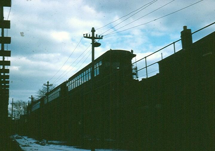 (107k, 720x508)<br><b>Country:</b> United States<br><b>City:</b> New York<br><b>System:</b> New York City Transit<br><b>Line:</b> BMT Myrtle Avenue Line<br><b>Location:</b> Fresh Pond Road <br><b>Car:</b> BMT Elevated Gate Car  <br><b>Photo by:</b> Brian J. Cudahy<br><b>Date:</b> 1959<br><b>Notes:</b> BU cars on Myrtle at Fresh Pond.<br><b>Viewed (this week/total):</b> 1 / 1582