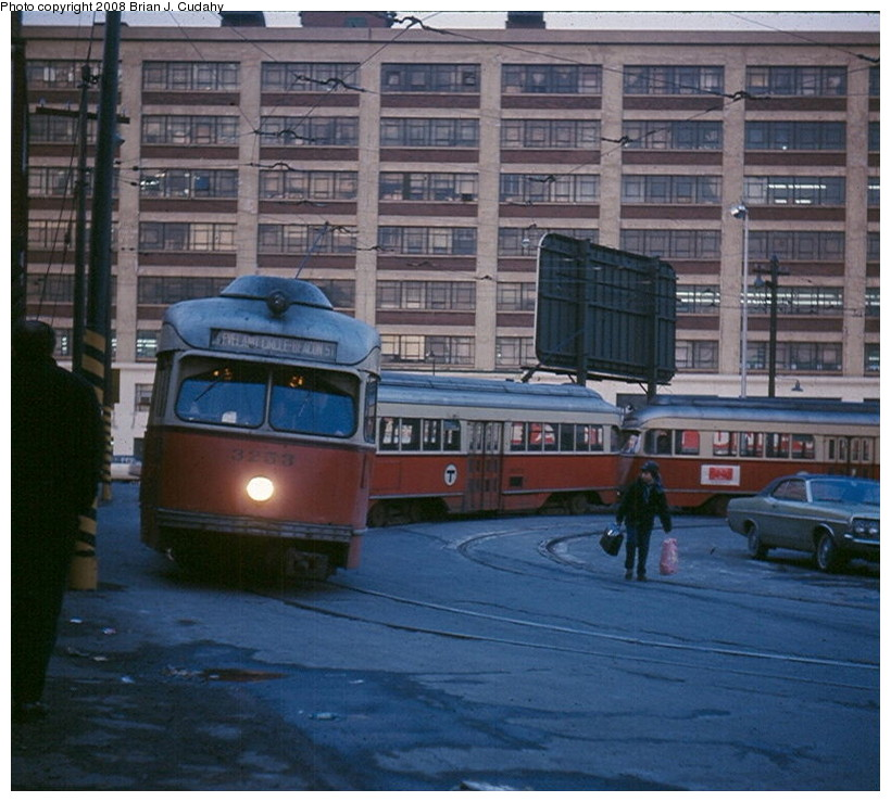 (164k, 820x739)<br><b>Country:</b> United States<br><b>City:</b> Boston, MA<br><b>System:</b> MBTA<br><b>Line:</b> MBTA Green <br><b>Location:</b> Lechmere <br><b>Car:</b> MBTA/BSRy PCC Wartime (Pullman-Standard, 1945-46)  3253 <br><b>Photo by:</b> Brian J. Cudahy<br><b>Date:</b> 1970<br><b>Notes:</b> Three-car train of PCC cars on Lechmere loop.<br><b>Viewed (this week/total):</b> 0 / 1752