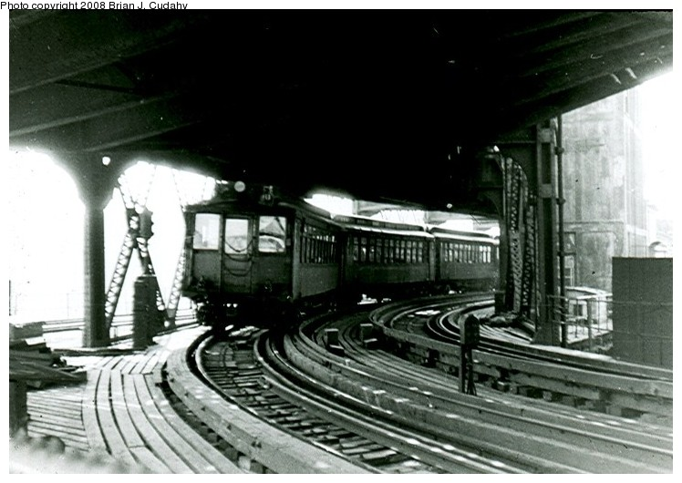 (114k, 748x530)<br><b>Country:</b> United States<br><b>City:</b> New York<br><b>System:</b> New York City Transit<br><b>Line:</b> 3rd Avenue El<br><b>Location:</b> 129th Street <br><b>Car:</b> MUDC  <br><b>Photo by:</b> Brian J. Cudahy<br><b>Date:</b> 1955<br><b>Viewed (this week/total):</b> 6 / 3228