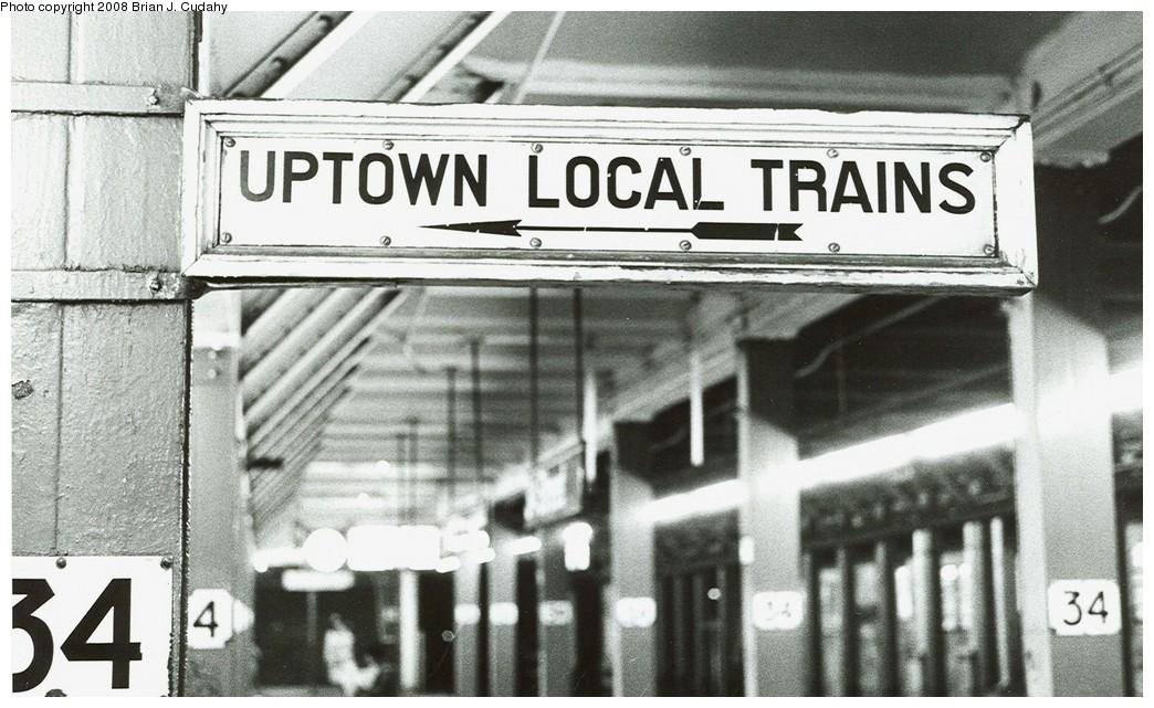 (208k, 1044x641)<br><b>Country:</b> United States<br><b>City:</b> New York<br><b>System:</b> New York City Transit<br><b>Line:</b> BMT Broadway Line<br><b>Location:</b> 34th Street/Herald Square <br><b>Photo by:</b> Brian J. Cudahy<br><b>Date:</b> 1982<br><b>Notes:</b> Uptown local trains sign at 34th Street station of Broadway BMT.<br><b>Viewed (this week/total):</b> 0 / 2409