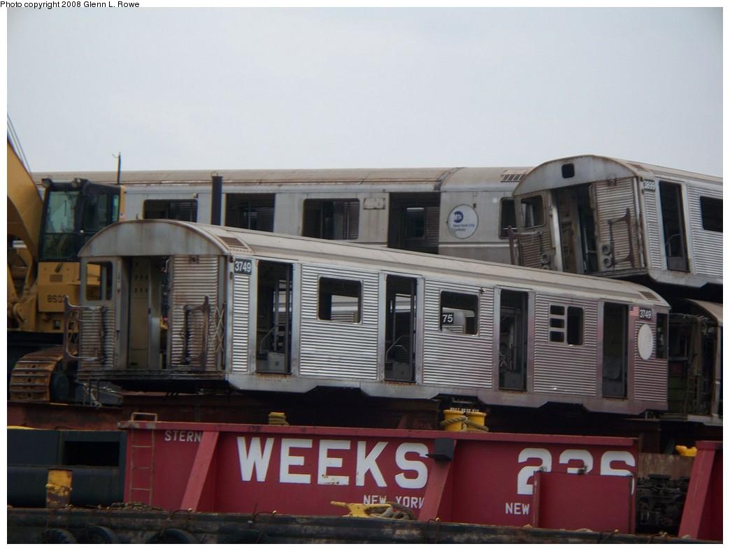 (172k, 1044x788)<br><b>Country:</b> United States<br><b>City:</b> New York<br><b>System:</b> New York City Transit<br><b>Location:</b> 207th Street Yard<br><b>Car:</b> R-32 (Budd, 1964)  3749/3899 <br><b>Photo by:</b> Glenn L. Rowe<br><b>Date:</b> 7/9/2008<br><b>Notes:</b> Barge-Scrapping<br><b>Viewed (this week/total):</b> 1 / 1853