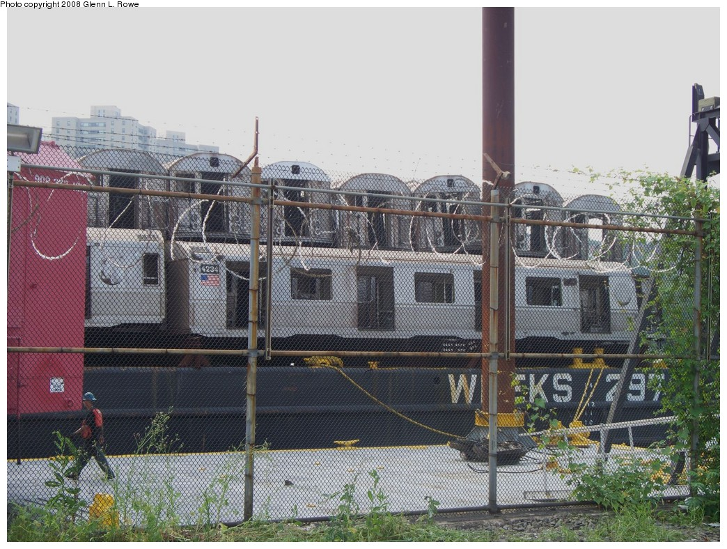 (295k, 1044x788)<br><b>Country:</b> United States<br><b>City:</b> New York<br><b>System:</b> New York City Transit<br><b>Location:</b> 207th Street Yard<br><b>Car:</b> R-40 (St. Louis, 1968)  4234 <br><b>Photo by:</b> Glenn L. Rowe<br><b>Date:</b> 7/9/2008<br><b>Notes:</b> Barge-Scrapping<br><b>Viewed (this week/total):</b> 0 / 1141
