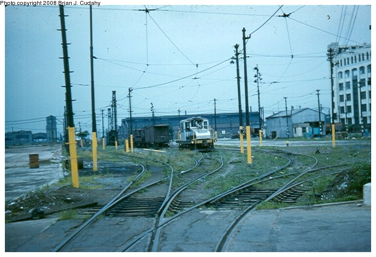 (135k, 770x526)<br><b>Country:</b> United States<br><b>City:</b> New York<br><b>System:</b> New York City Transit<br><b>Location:</b> 2nd Avenue & 39th St.<br><b>Car:</b> SBK Steeplecab  <br><b>Photo by:</b> Brian J. Cudahy<br><b>Date:</b> 7/4/1954<br><b>Notes:</b> South Brooklyn 39th Street Yard w/steeple cab locomotive.<br><b>Viewed (this week/total):</b> 1 / 2369