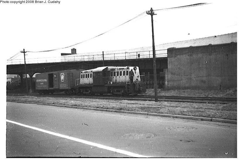 (128k, 820x549)<br><b>Country:</b> United States<br><b>City:</b> New York<br><b>System:</b> New York City Transit<br><b>Location:</b> 36th Street Yard<br><b>Car:</b> Whitcomb Locomotive 8 <br><b>Photo by:</b> Brian J. Cudahy<br><b>Date:</b> 1956<br><b>Notes:</b> South Brooklyn diesel No. 8 leaving right-of-way under Culver Line and entering 36th Street Yard.<br><b>Viewed (this week/total):</b> 0 / 1826