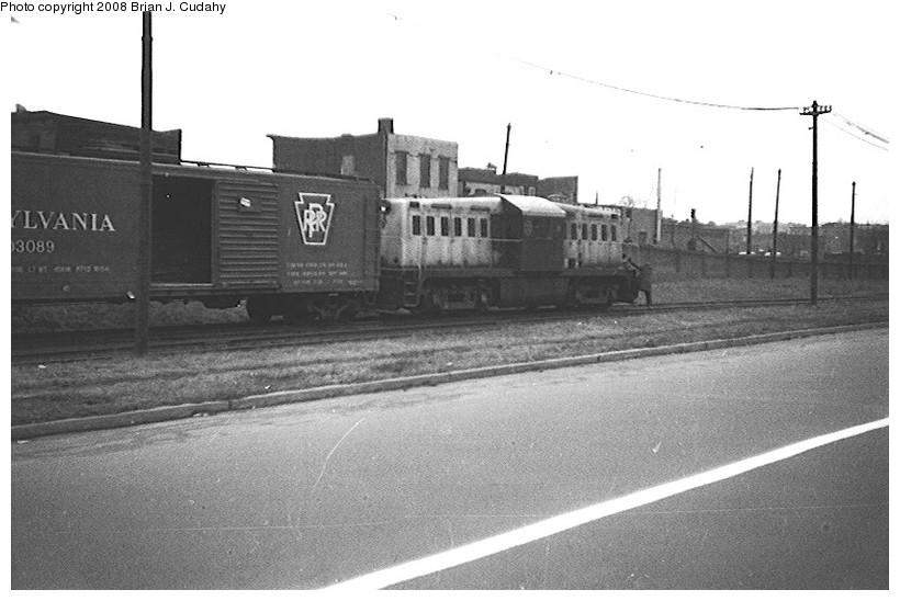 (123k, 820x548)<br><b>Country:</b> United States<br><b>City:</b> New York<br><b>System:</b> New York City Transit<br><b>Location:</b> 36th Street Yard<br><b>Car:</b> Whitcomb Locomotive 8 <br><b>Photo by:</b> Brian J. Cudahy<br><b>Date:</b> 1956<br><b>Notes:</b> South Brooklyn diesel No. 8 leaving right-of-way under Culver Line and entering 36th Street Yard.<br><b>Viewed (this week/total):</b> 6 / 1728