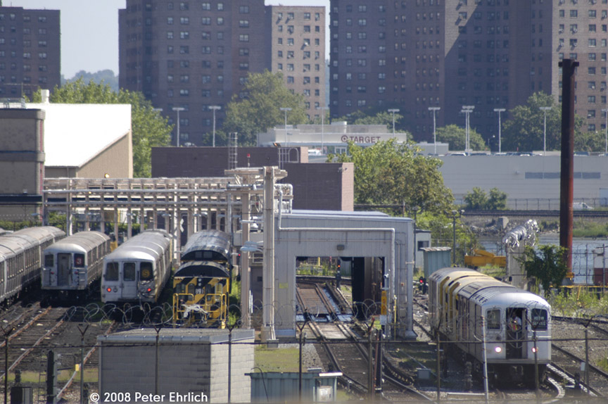 (200k, 864x574)<br><b>Country:</b> United States<br><b>City:</b> New York<br><b>System:</b> New York City Transit<br><b>Location:</b> 207th Street Yard<br><b>Photo by:</b> Peter Ehrlich<br><b>Date:</b> 7/15/2008<br><b>Notes:</b> General overview from 207th Street Bridge.  Trash train on right.<br><b>Viewed (this week/total):</b> 0 / 1207