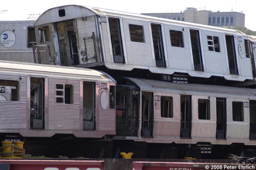 (181k, 864x574)<br><b>Country:</b> United States<br><b>City:</b> New York<br><b>System:</b> New York City Transit<br><b>Location:</b> 207th Street Yard<br><b>Car:</b> R-32 (Budd, 1964)  3899 <br><b>Photo by:</b> Peter Ehrlich<br><b>Date:</b> 7/15/2008<br><b>Notes:</b> Scrap barge.<br><b>Viewed (this week/total):</b> 1 / 1482