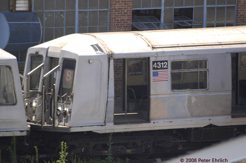 (142k, 864x574)<br><b>Country:</b> United States<br><b>City:</b> New York<br><b>System:</b> New York City Transit<br><b>Location:</b> 207th Street Yard<br><b>Car:</b> R-40 (St. Louis, 1968)  4312 <br><b>Photo by:</b> Peter Ehrlich<br><b>Date:</b> 7/15/2008<br><b>Notes:</b> R40s being set up for scrap line.<br><b>Viewed (this week/total):</b> 1 / 1774