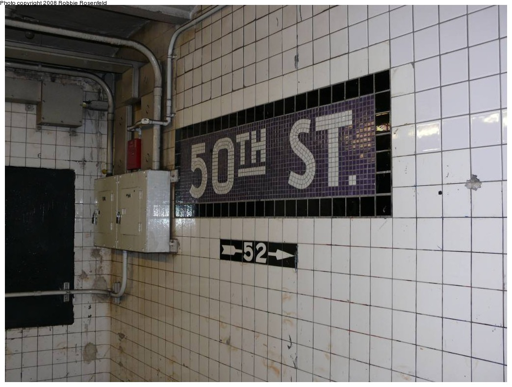 (198k, 1044x788)<br><b>Country:</b> United States<br><b>City:</b> New York<br><b>System:</b> New York City Transit<br><b>Line:</b> IND Queens Boulevard Line<br><b>Location:</b> 50th Street <br><b>Photo by:</b> Robbie Rosenfeld<br><b>Date:</b> 7/11/2008<br><b>Notes:</b> 52nd St directional sign at 50th St.<br><b>Viewed (this week/total):</b> 0 / 1347