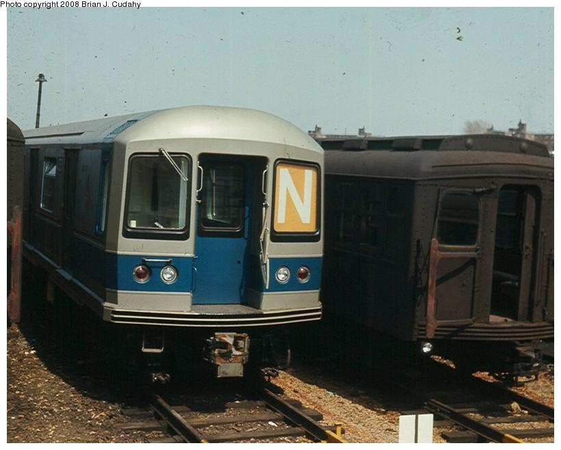(125k, 820x658)<br><b>Country:</b> United States<br><b>City:</b> New York<br><b>System:</b> New York City Transit<br><b>Location:</b> Rockaway Parkway (Canarsie) Yard<br><b>Car:</b> R-40M (St. Louis, 1969)  4303 <br><b>Photo by:</b> Brian J. Cudahy<br><b>Date:</b> 4/9/1969<br><b>Notes:</b> R-40M and BMT Standards at Rockaway Parkway Yard.<br><b>Viewed (this week/total):</b> 1 / 1905