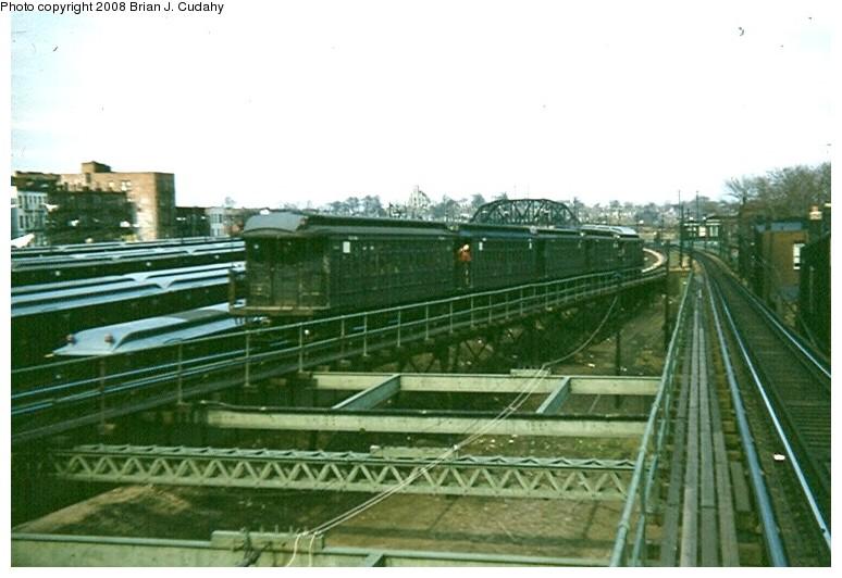 (115k, 774x532)<br><b>Country:</b> United States<br><b>City:</b> New York<br><b>System:</b> New York City Transit<br><b>Line:</b> BMT Myrtle Avenue Line<br><b>Location:</b> Fresh Pond Road <br><b>Car:</b> BMT Elevated Gate Car  <br><b>Photo by:</b> Brian J. Cudahy<br><b>Date:</b> 3/1960<br><b>Notes:</b> Five car train of BU units moves onto Myrtle Avenue el structure at Fresh Pond.<br><b>Viewed (this week/total):</b> 6 / 2358