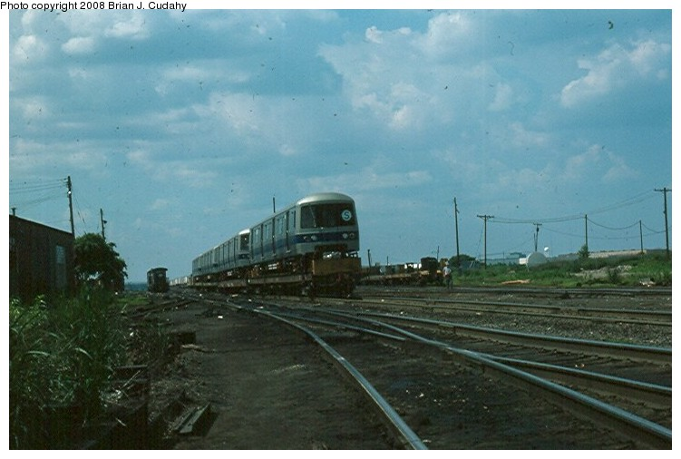 (101k, 751x506)<br><b>Country:</b> United States<br><b>City:</b> New York<br><b>System:</b> New York City Transit<br><b>Car:</b> R-46 (Pullman-Standard, 1974-75)  <br><b>Collection of:</b> Brian J. Cudahy<br><b>Date:</b> 7/1976<br><b>Notes:</b> Pullman-built R-46 units about to be shipped east. (Near Chicago).<br><b>Viewed (this week/total):</b> 3 / 1647