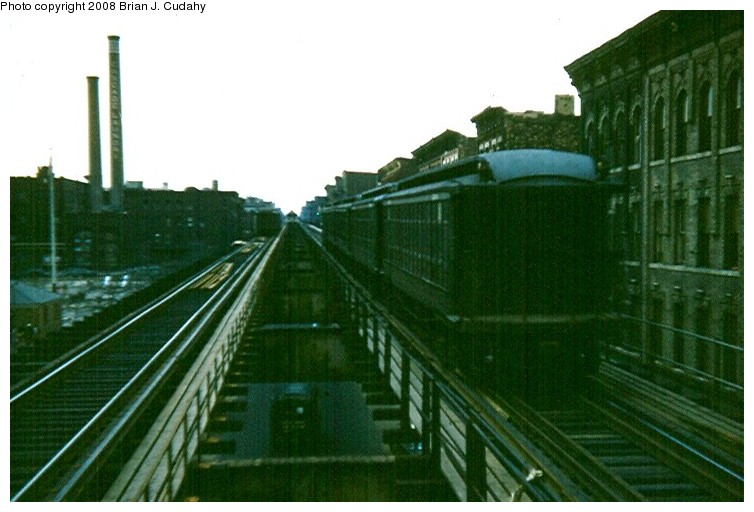 (111k, 754x512)<br><b>Country:</b> United States<br><b>City:</b> New York<br><b>System:</b> New York City Transit<br><b>Line:</b> BMT Myrtle Avenue Line<br><b>Location:</b> Nostrand Avenue <br><b>Car:</b> BMT Elevated Gate Car  <br><b>Photo by:</b> Brian J. Cudahy<br><b>Date:</b> 3/1960<br><b>Notes:</b> Cascade laundry buildings at left still exist in 2008<br><b>Viewed (this week/total):</b> 7 / 3005