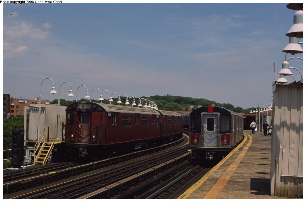 (153k, 1044x691)<br><b>Country:</b> United States<br><b>City:</b> New York<br><b>System:</b> New York City Transit<br><b>Line:</b> IRT White Plains Road Line<br><b>Location:</b> West Farms Sq./East Tremont Ave./177th St. <br><b>Route:</b> 2<br><b>Car:</b> R-33 Main Line (St. Louis, 1962-63) 8938 <br><b>Photo by:</b> Chao-Hwa Chen<br><b>Date:</b> 7/3/2001<br><b>Notes:</b> With R142 6340<br><b>Viewed (this week/total):</b> 1 / 2156