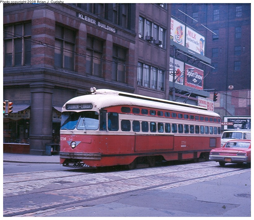 (160k, 820x713)<br><b>Country:</b> United States<br><b>City:</b> Pittsburgh, PA<br><b>System:</b> PAT<br><b>Car:</b> Pittsburgh Railways/PAT PCC 1716 <br><b>Photo by:</b> Brian J. Cudahy<br><b>Date:</b> 1963<br><b>Notes:</b> PCC car No 1716 on Shannon-Library Line in downtown Pittsburgh.<br><b>Viewed (this week/total):</b> 3 / 1380