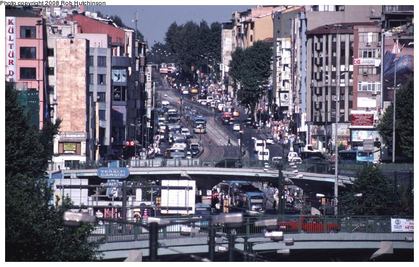 (197k, 820x524)<br><b>Country:</b> Turkey<br><b>City:</b> Istanbul<br><b>System:</b> İstanbul Ulaşım (Istanbul Transport)<br><b>Line:</b> T1 Kabatas-Bagcilar <br><b>Location:</b> Aksaray (T1) <br><b>Photo by:</b> Rob Hutchinson<br><b>Date:</b> 7/8/2008<br><b>Notes:</b> Looking up the Ordu cad. from the Aksaray stop two tram trains can be seen.<br><b>Viewed (this week/total):</b> 2 / 883