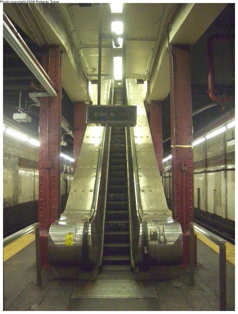 (221k, 791x1044)<br><b>Country:</b> United States<br><b>City:</b> New York<br><b>System:</b> New York City Transit<br><b>Line:</b> BMT Nassau Street-Jamaica Line<br><b>Location:</b> Bowery<br><b>Photo by:</b> Roberto C. Tobar<br><b>Date:</b> 8/16/2008<br><b>Notes:</b> Narrow escalator to mezzanine.<br><b>Viewed (this week/total):</b> 2 / 2556