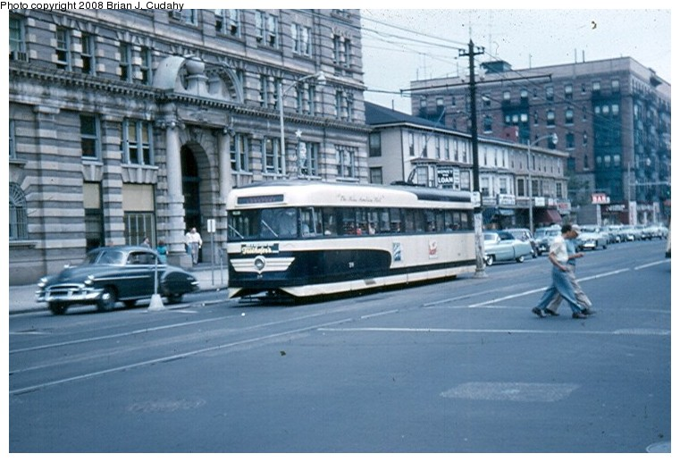 (124k, 761x517)<br><b>Country:</b> United States<br><b>City:</b> Atlantic City, NJ<br><b>System:</b> Atlantic City Transit<br><b>Car:</b> Atlantic City Brilliner (J.G. Brill, 1940)  <br><b>Photo by:</b> Brian J. Cudahy<br><b>Date:</b> 8/3/1954<br><b>Notes:</b> Margate-bound Brilliner on Atlantic Avenue.<br><b>Viewed (this week/total):</b> 12 / 2311