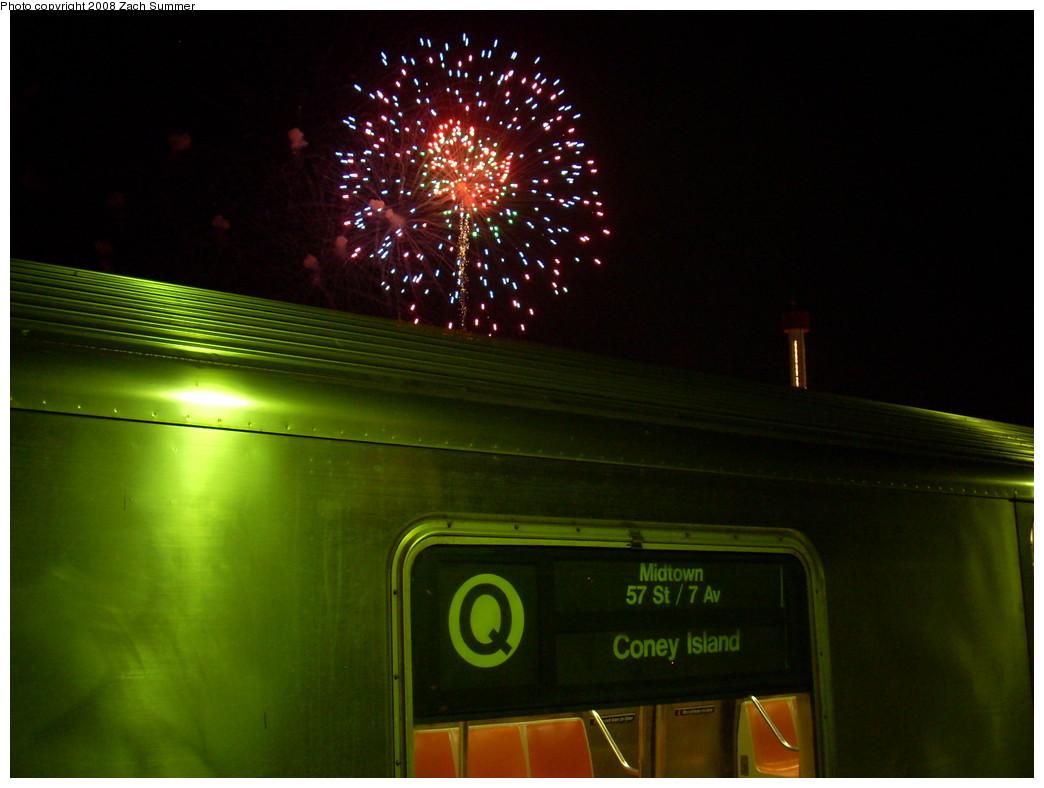 (197k, 1044x788)<br><b>Country:</b> United States<br><b>City:</b> New York<br><b>System:</b> New York City Transit<br><b>Line:</b> BMT Brighton Line<br><b>Location:</b> West 8th Street <br><b>Route:</b> Q<br><b>Car:</b> R-68A (Kawasaki, 1988-1989)  5035 <br><b>Photo by:</b> Zach Summer<br><b>Date:</b> 7/18/2008<br><b>Notes:</b> With fireworks.<br><b>Viewed (this week/total):</b> 4 / 2621