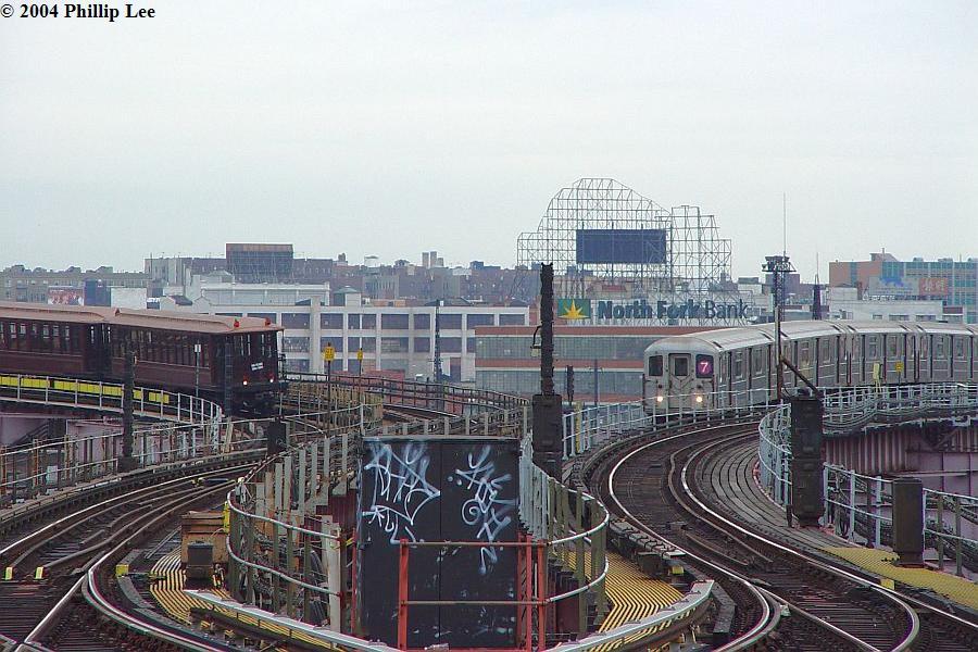 (114k, 900x600)<br><b>Country:</b> United States<br><b>City:</b> New York<br><b>System:</b> New York City Transit<br><b>Line:</b> BMT Astoria Line<br><b>Location:</b> Queensborough Plaza <br><b>Route:</b> Fan Trip<br><b>Car:</b> BMT Elevated Gate Car 1404-1273-1407 <br><b>Photo by:</b> Phillip Lee<br><b>Date:</b> 10/29/2004<br><b>Viewed (this week/total):</b> 1 / 2418