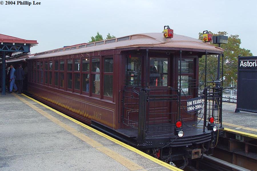 (108k, 900x600)<br><b>Country:</b> United States<br><b>City:</b> New York<br><b>System:</b> New York City Transit<br><b>Line:</b> BMT Astoria Line<br><b>Location:</b> Astoria Boulevard/Hoyt Avenue <br><b>Route:</b> Fan Trip<br><b>Car:</b> BMT Elevated Gate Car 1404-1273-1407 <br><b>Photo by:</b> Phillip Lee<br><b>Date:</b> 10/29/2004<br><b>Viewed (this week/total):</b> 1 / 1162