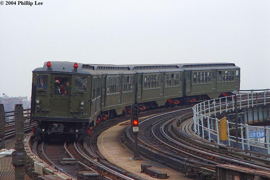 (98k, 900x600)<br><b>Country:</b> United States<br><b>City:</b> New York<br><b>System:</b> New York City Transit<br><b>Line:</b> IRT Pelham Line<br><b>Location:</b> Whitlock Avenue <br><b>Route:</b> Fan Trip<br><b>Car:</b> Low-V (Museum Train)  <br><b>Photo by:</b> Phillip Lee<br><b>Date:</b> 12/19/2004<br><b>Viewed (this week/total):</b> 0 / 1578