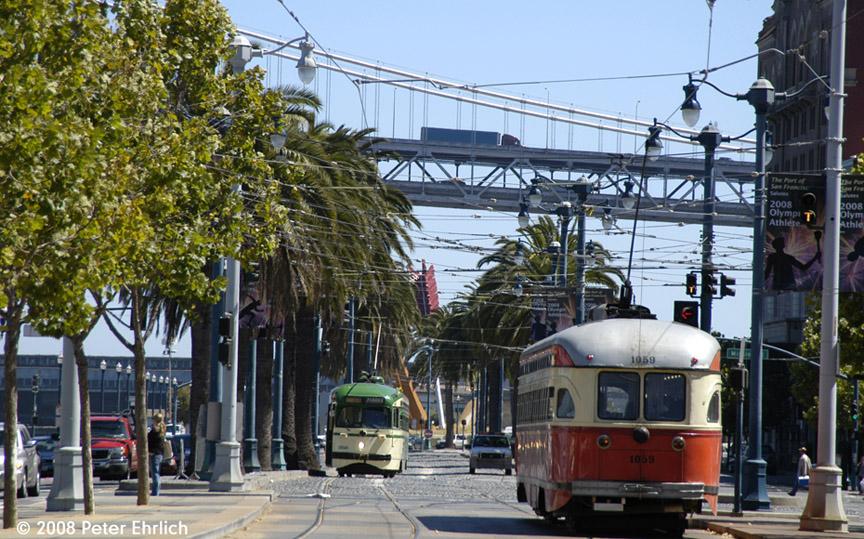 (247k, 864x539)<br><b>Country:</b> United States<br><b>City:</b> San Francisco/Bay Area, CA<br><b>System:</b> SF MUNI<br><b>Location:</b> Embarcadero/Ferry Plaza Layover <br><b>Car:</b> SF MUNI PCC (Ex-SEPTA) (St. Louis Car Co., 1947-1948)  1059 <br><b>Photo by:</b> Peter Ehrlich<br><b>Date:</b> 8/25/2008<br><b>Notes:</b> Ferry Plaza, outbound. Trailing view.  With 1050 (Muni Wings) laying over as shuttle car.<br><b>Viewed (this week/total):</b> 0 / 360