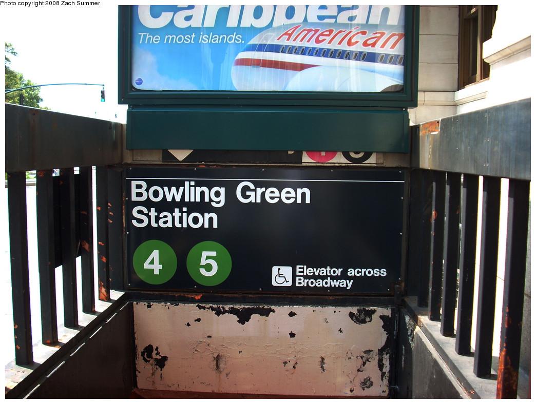 (252k, 1044x788)<br><b>Country:</b> United States<br><b>City:</b> New York<br><b>System:</b> New York City Transit<br><b>Line:</b> IRT East Side Line<br><b>Location:</b> Bowling Green <br><b>Photo by:</b> Zach Summer<br><b>Date:</b> 7/21/2008<br><b>Notes:</b> Bowling Green station entrance; Note old Pink 4 & Black 5 decals under advertisment<br><b>Viewed (this week/total):</b> 2 / 1930