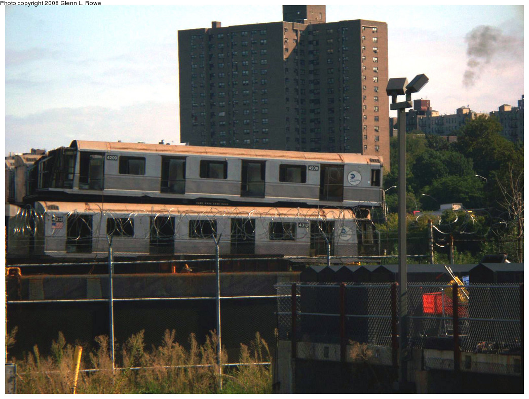 (258k, 1044x788)<br><b>Country:</b> United States<br><b>City:</b> New York<br><b>System:</b> New York City Transit<br><b>Location:</b> 207th Street Yard<br><b>Car:</b> R-40 (St. Louis, 1968)  4209/4313 <br><b>Photo by:</b> Glenn L. Rowe<br><b>Date:</b> 9/30/2008<br><b>Notes:</b> Barge-Scrapping<br><b>Viewed (this week/total):</b> 0 / 1935