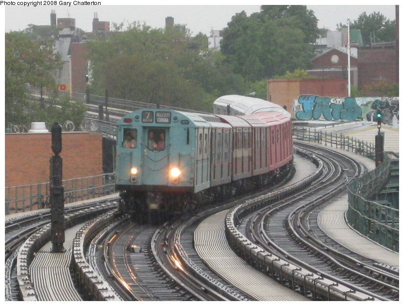 (157k, 820x620)<br><b>Country:</b> United States<br><b>City:</b> New York<br><b>System:</b> New York City Transit<br><b>Line:</b> IRT Flushing Line<br><b>Location:</b> 61st Street/Woodside <br><b>Route:</b> Museum Train Service (7)<br><b>Car:</b> R-33 World's Fair (St. Louis, 1963-64) 9306 <br><b>Photo by:</b> Gary Chatterton<br><b>Date:</b> 9/28/2008<br><b>Notes:</b> Shea Stadium closing day special<br><b>Viewed (this week/total):</b> 1 / 1733