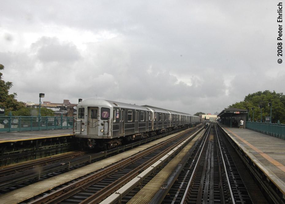 (176k, 930x667)<br><b>Country:</b> United States<br><b>City:</b> New York<br><b>System:</b> New York City Transit<br><b>Line:</b> IRT Flushing Line<br><b>Location:</b> 103rd Street/Corona Plaza <br><b>Route:</b> 7<br><b>Car:</b> R-62A (Bombardier, 1984-1987)  1716 <br><b>Photo by:</b> Peter Ehrlich<br><b>Date:</b> 9/28/2008<br><b>Notes:</b> 103 St-Corona Plaza, inbound train.<br><b>Viewed (this week/total):</b> 0 / 1427