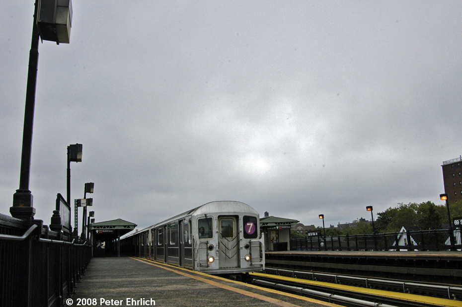 (516k, 930x618)<br><b>Country:</b> United States<br><b>City:</b> New York<br><b>System:</b> New York City Transit<br><b>Line:</b> IRT Flushing Line<br><b>Location:</b> 69th Street/Fisk Avenue <br><b>Route:</b> 7<br><b>Car:</b> R-62A (Bombardier, 1984-1987)  1736 <br><b>Photo by:</b> Peter Ehrlich<br><b>Date:</b> 9/28/2008<br><b>Notes:</b> 69 Street-Fisk Avenue, inbound train.<br><b>Viewed (this week/total):</b> 1 / 1248