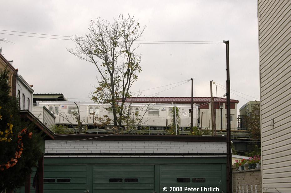 (194k, 930x618)<br><b>Country:</b> United States<br><b>City:</b> New York<br><b>System:</b> New York City Transit<br><b>Line:</b> BMT Myrtle Avenue Line<br><b>Location:</b> Fresh Pond Road <br><b>Route:</b> M<br><b>Car:</b> R-160A-1 (Alstom, 2005-2008, 4 car sets)  8365 <br><b>Photo by:</b> Peter Ehrlich<br><b>Date:</b> 9/30/2008<br><b>Notes:</b> Outbound train, view from 68th Avenue through backyard.<br><b>Viewed (this week/total):</b> 0 / 2281
