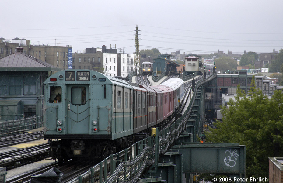 (199k, 930x602)<br><b>Country:</b> United States<br><b>City:</b> New York<br><b>System:</b> New York City Transit<br><b>Line:</b> IRT Flushing Line<br><b>Location:</b> 69th Street/Fisk Avenue <br><b>Route:</b> Museum Train Service (7)<br><b>Car:</b> R-33 World's Fair (St. Louis, 1963-64) 9306 <br><b>Photo by:</b> Peter Ehrlich<br><b>Date:</b> 8/28/2008<br><b>Notes:</b> Leaving 69 St-Fisk Avenue inbound, trailing view.<br><b>Viewed (this week/total):</b> 9 / 1809