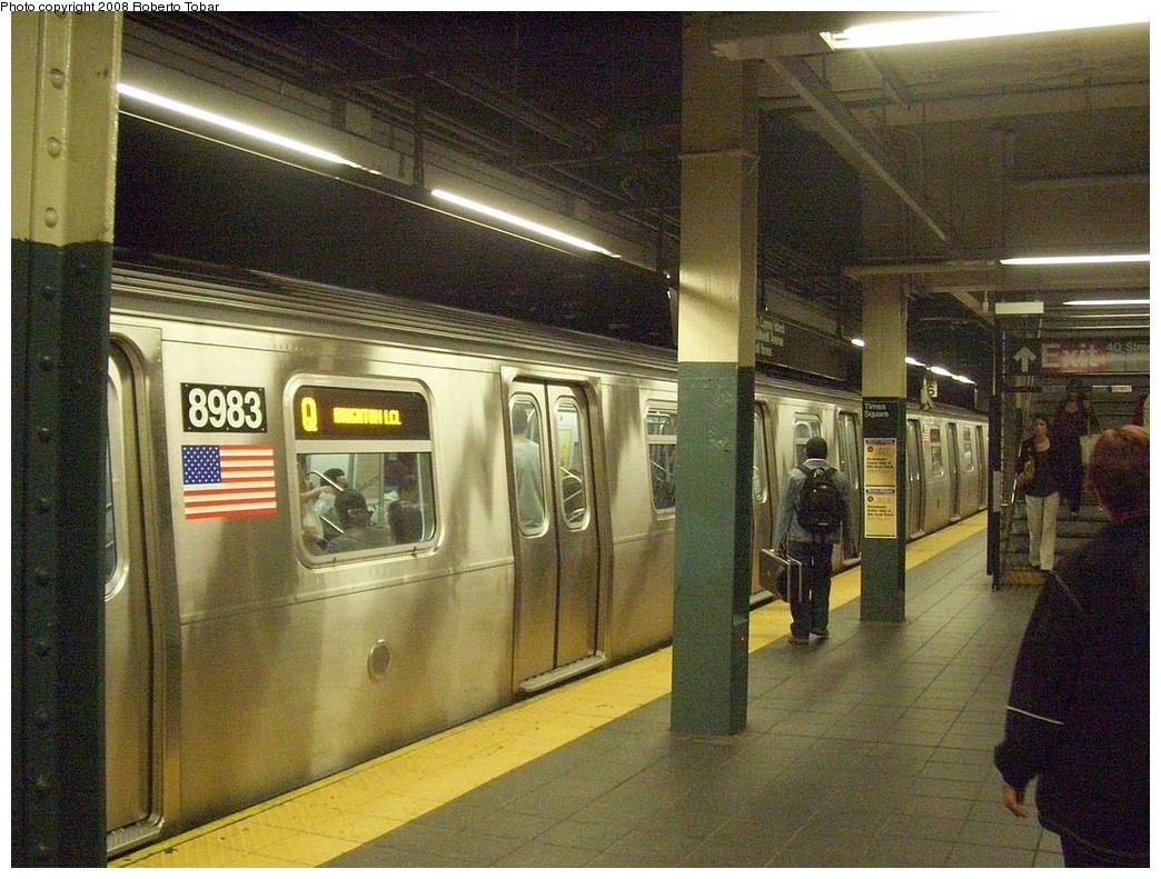 (272k, 1044x791)<br><b>Country:</b> United States<br><b>City:</b> New York<br><b>System:</b> New York City Transit<br><b>Line:</b> BMT Broadway Line<br><b>Location:</b> Times Square/42nd Street <br><b>Route:</b> Q<br><b>Car:</b> R-160B (Option 1) (Kawasaki, 2008-2009)  8983 <br><b>Photo by:</b> Roberto C. Tobar<br><b>Date:</b> 10/10/2008<br><b>Viewed (this week/total):</b> 8 / 3569