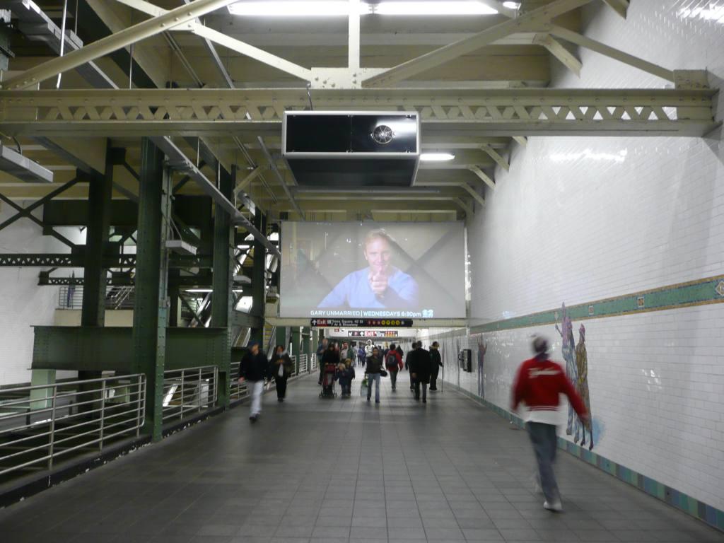 (111k, 1024x768)<br><b>Country:</b> United States<br><b>City:</b> New York<br><b>System:</b> New York City Transit<br><b>Line:</b> IRT Flushing Line<br><b>Location:</b> Times Square <br><b>Photo by:</b> Robbie Rosenfeld<br><b>Date:</b> 10/23/2008<br><b>Notes:</b> Ad projector in corridor above 7 line station. <i>Revelers</i> artwork on side wall.<br><b>Viewed (this week/total):</b> 6 / 2669