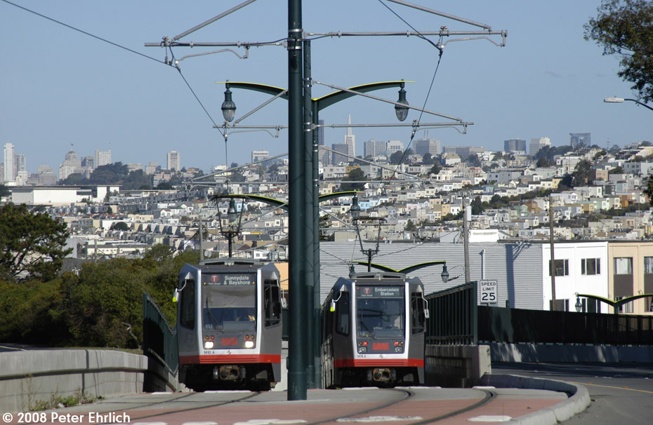 (216k, 930x606)<br><b>Country:</b> United States<br><b>City:</b> San Francisco/Bay Area, CA<br><b>System:</b> SF MUNI<br><b>Line:</b> MUNI 3rd Street Light Rail<br><b>Location:</b> Crossing Bayshore Blvd./Freeway <br><b>Car:</b> SF MUNI Breda LRV 1410 <br><b>Photo by:</b> Peter Ehrlich<br><b>Date:</b> 11/9/2008<br><b>Notes:</b> Bayshore/US 101 (south end of Le Conte cut), inbound. With 1476 outbound.<br><b>Viewed (this week/total):</b> 1 / 641