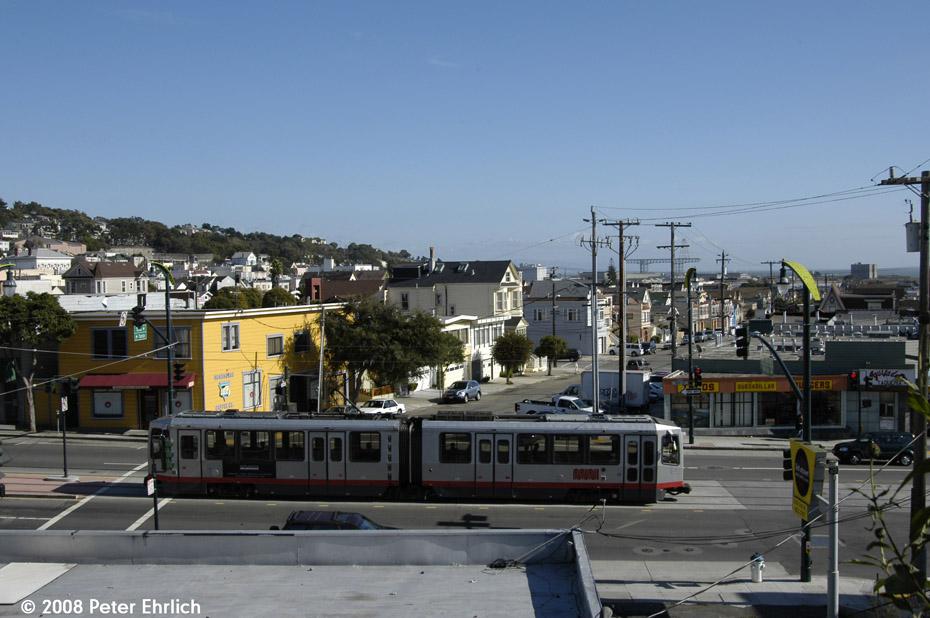(184k, 930x618)<br><b>Country:</b> United States<br><b>City:</b> San Francisco/Bay Area, CA<br><b>System:</b> SF MUNI<br><b>Line:</b> MUNI 3rd Street Light Rail<br><b>Location:</b> 3rd Street/Thornton/Thomas <br><b>Car:</b> SF MUNI Breda LRV 1410 <br><b>Photo by:</b> Peter Ehrlich<br><b>Date:</b> 11/9/2008<br><b>Notes:</b> 3rd/Thornton/Thomas, inbound.<br><b>Viewed (this week/total):</b> 0 / 660