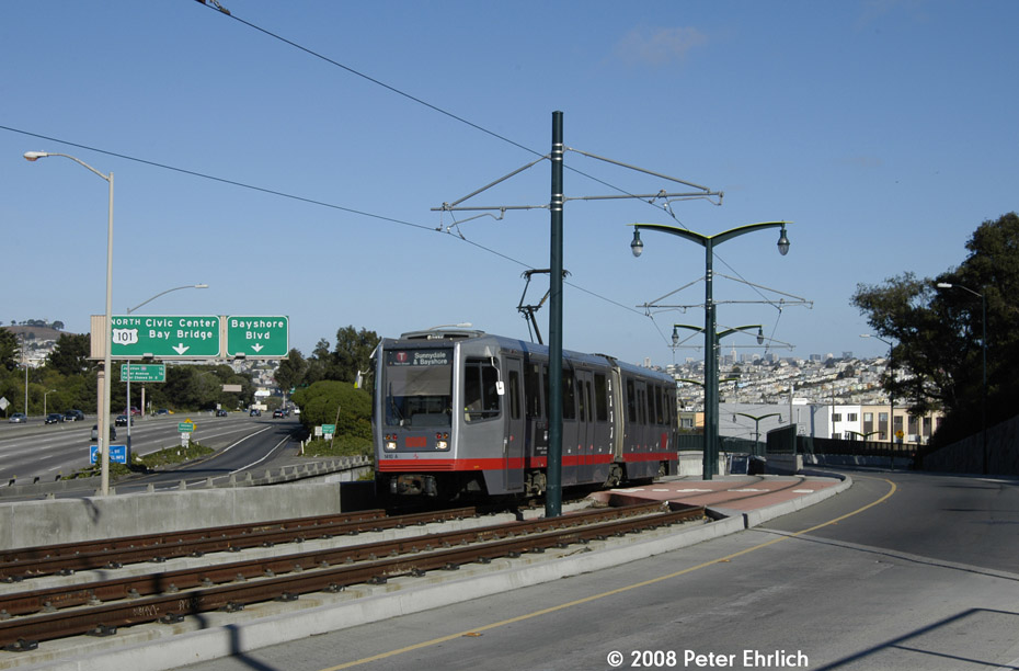 (169k, 930x612)<br><b>Country:</b> United States<br><b>City:</b> San Francisco/Bay Area, CA<br><b>System:</b> SF MUNI<br><b>Line:</b> MUNI 3rd Street Light Rail<br><b>Location:</b> Crossing Bayshore Blvd./Freeway <br><b>Car:</b> SF MUNI Breda LRV 1410 <br><b>Photo by:</b> Peter Ehrlich<br><b>Date:</b> 11/9/2008<br><b>Notes:</b> Bayshore/US 101 Freeway, inbound.<br><b>Viewed (this week/total):</b> 0 / 483