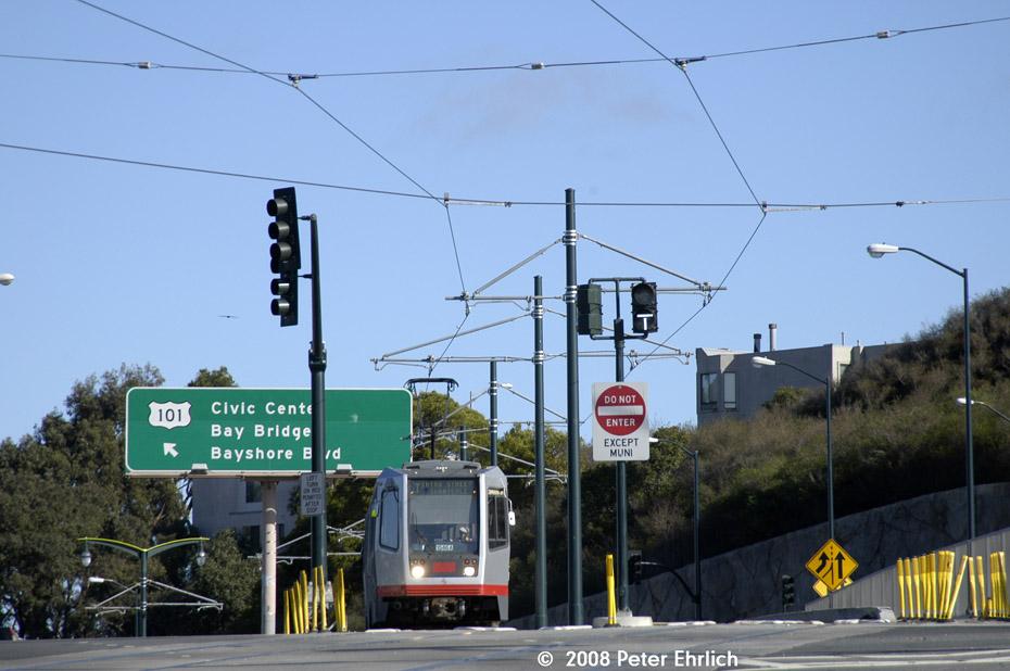 (174k, 930x618)<br><b>Country:</b> United States<br><b>City:</b> San Francisco/Bay Area, CA<br><b>System:</b> SF MUNI<br><b>Line:</b> MUNI 3rd Street Light Rail<br><b>Location:</b> Crossing Bayshore Blvd./Freeway <br><b>Car:</b> SF MUNI Breda LRV 1546 <br><b>Photo by:</b> Peter Ehrlich<br><b>Date:</b> 11/9/2008<br><b>Notes:</b> Bayshore/US 101 Freeway, inbound.<br><b>Viewed (this week/total):</b> 0 / 555
