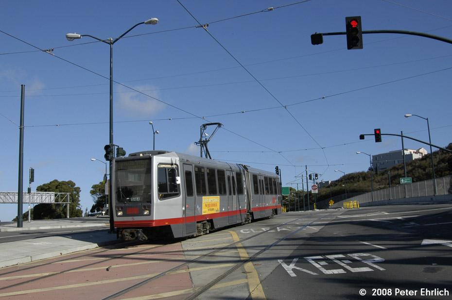 (158k, 930x618)<br><b>Country:</b> United States<br><b>City:</b> San Francisco/Bay Area, CA<br><b>System:</b> SF MUNI<br><b>Line:</b> MUNI 3rd Street Light Rail<br><b>Location:</b> Crossing Bayshore Blvd./Freeway <br><b>Car:</b> SF MUNI Breda LRV 1546 <br><b>Photo by:</b> Peter Ehrlich<br><b>Date:</b> 11/9/2008<br><b>Notes:</b> Bayshore/US 101 Freeway, inbound.<br><b>Viewed (this week/total):</b> 0 / 518