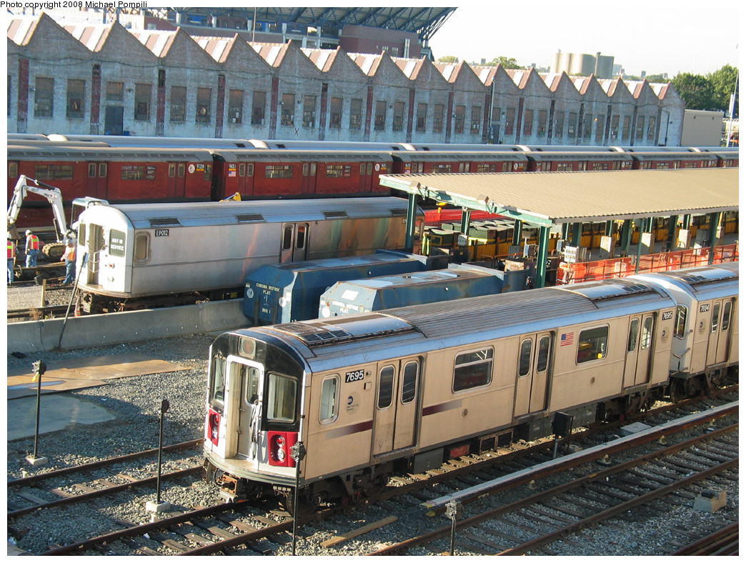 (375k, 1044x788)<br><b>Country:</b> United States<br><b>City:</b> New York<br><b>System:</b> New York City Transit<br><b>Location:</b> Corona Yard<br><b>Car:</b> R-142A (Option Order, Kawasaki, 2002-2003)  7695 <br><b>Photo by:</b> Michael Pompili<br><b>Date:</b> 10/20/2003<br><b>Viewed (this week/total):</b> 5 / 1807