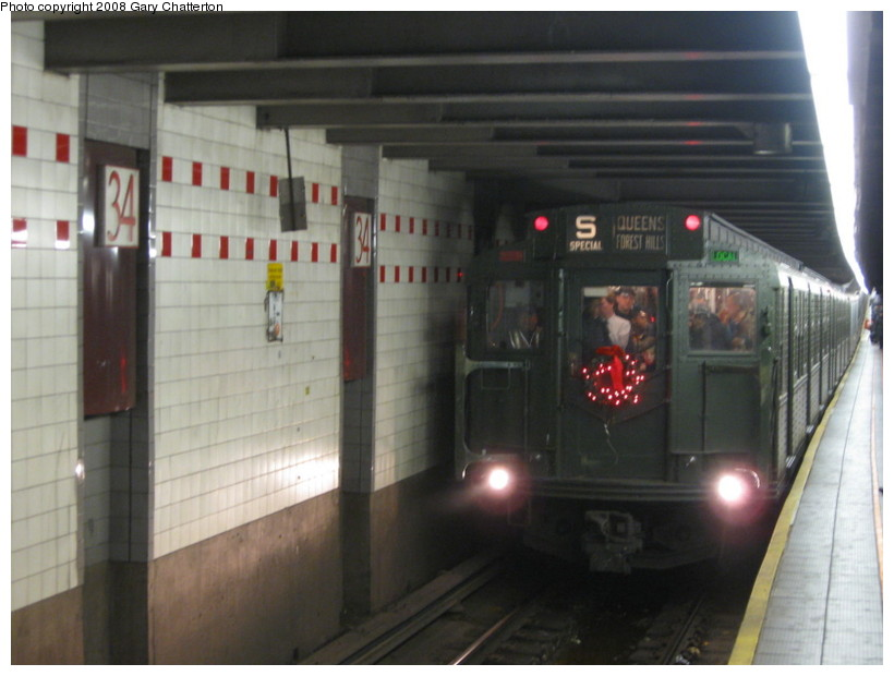 (106k, 820x620)<br><b>Country:</b> United States<br><b>City:</b> New York<br><b>System:</b> New York City Transit<br><b>Line:</b> IND 6th Avenue Line<br><b>Location:</b> 34th Street/Herald Square <br><b>Route:</b> Museum Train Service (V)<br><b>Car:</b> R-1 (American Car & Foundry, 1930-1931) 100 <br><b>Photo by:</b> Gary Chatterton<br><b>Date:</b> 11/30/2008<br><b>Viewed (this week/total):</b> 0 / 1729